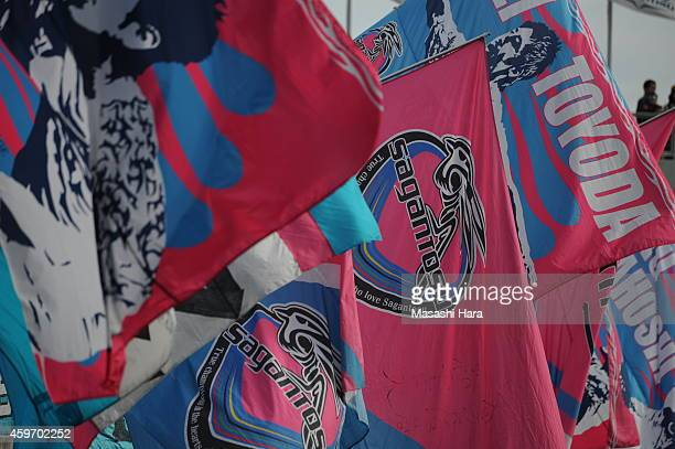 Sagan Tosu supporters wave flags prior to the JLeague match between Sagan Tosu and Urawa Red Diamonds at Best Amenity Stadium on November 29 2014 in...