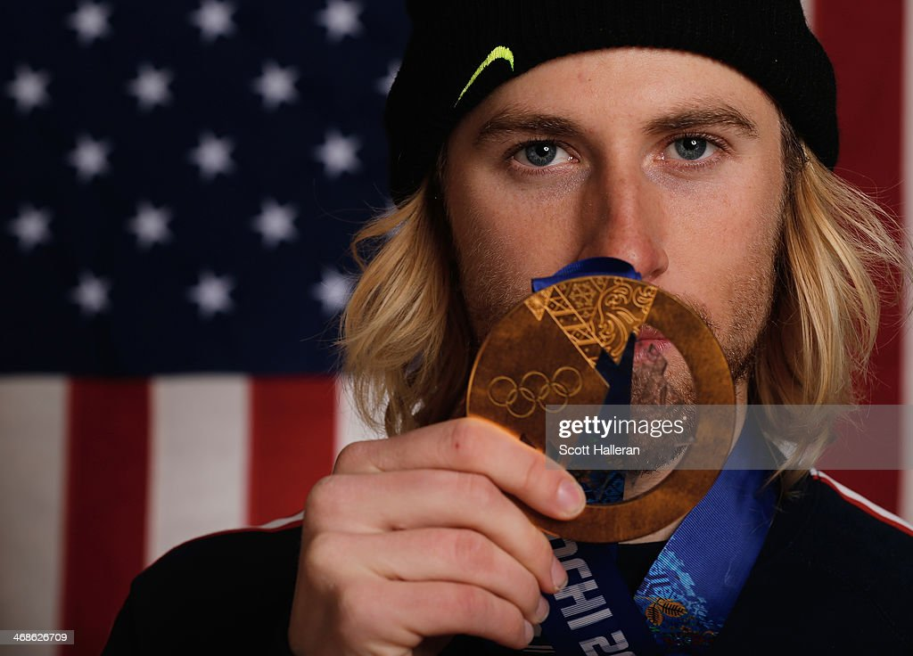 <a gi-track='captionPersonalityLinkClicked' href=/galleries/search?phrase=Sage+Kotsenburg&family=editorial&specificpeople=6711370 ng-click='$event.stopPropagation()'>Sage Kotsenburg</a> of the USA Snowboarding team poses in the Olympic Park with the first gold medal won during the Sochi 2014 Winter Olympics on February 10, 2014 in Sochi, Russia.