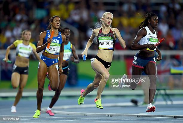 Sage Watson of Canada and Christine Ohuruogu of Great Britain compete in Round One of the Women's 4 x 400m Relay on Day 14 of the Rio 2016 Olympic...