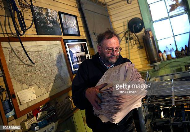 Saguache Crescent owner and editor Dean Coombs carries freshly printed copies of the Saguache Crescent newspaper on January 19 2016 in Saguache...