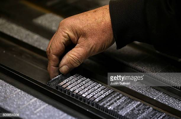 Saguache Crescent owner and editor Dean Coombs lays out blocks of metal type slugs that were created a vintage hot metal Linotype typesetting machine...