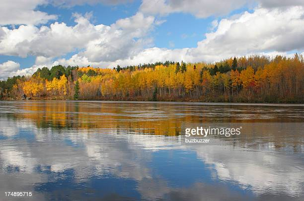 Saguenay River reflection of the sky and the Autumn colors