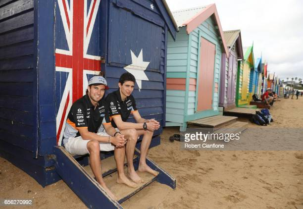 Sahara Force India F1 Team drivers Sergio Perez and Esteban Ocon pose for the media during previews to the Australian Formula One Grand Prix at...
