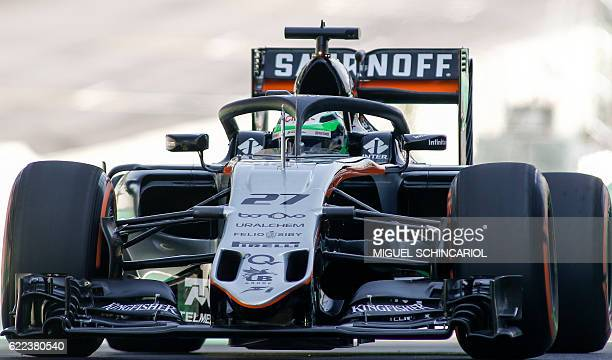 Sahara Force India F1 Team German driver Nico Hulkenberg tests the socalled halo cockpit protection device during first practice session of the...
