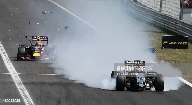 Sahara Force India F1 Team's German driver Nico Huelkenberg's car is damaged while competing during the Hungarian Formula One Grand Prix at the...