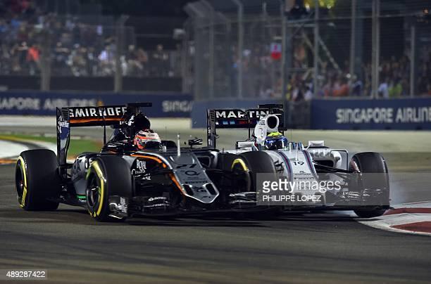 Sahara Force India F1 Team's German driver Nico Hulkenberg and Williams Martini Racing's Brazilian driver Felipe Massa bump into one another during...