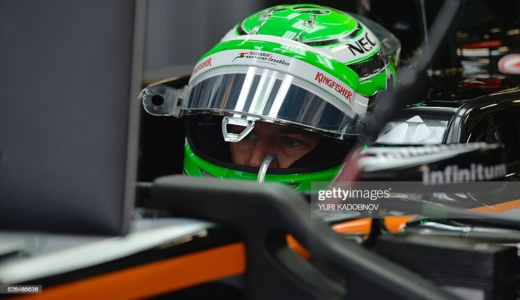 Sahara Force India F1 Team's German driver Nico Hulkenberg sits in his car during the third practice session of the Formula One Russian Grand Prix at the Sochi Autodrom circuit on April 30, 2016. / AFP / YURI