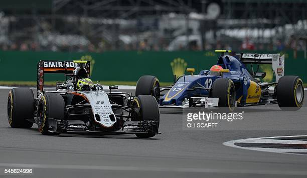 Sahara Force India F1 Team's Mexican driver Sergio Perez and Sauber F1 Team's Brazilian driver Felipe Nasr drives during the third practice session...