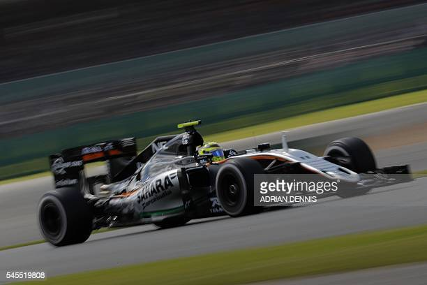 Sahara Force India F1 Team's Mexican driver Sergio Perez drives during the second practice session at Silverstone motor racing circuit in Silverstone...