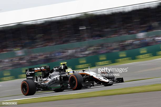 Sahara Force India F1 Team's Mexican driver Sergio Perez drives during the qualifying session at Silverstone motor racing circuit in Silverstone...