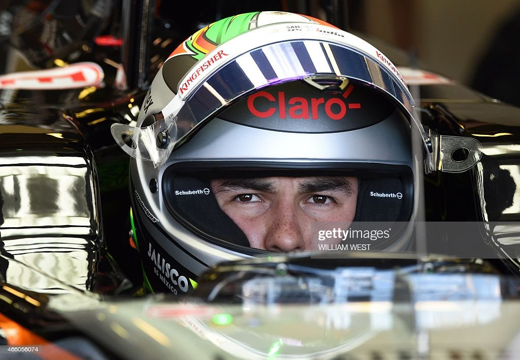 Sahara Force India F1 Team's Mexican driver <a gi-track='captionPersonalityLinkClicked' href=/galleries/search?phrase=Sergio+Perez+-+Mexican+Racing+Driver&family=editorial&specificpeople=7629400 ng-click='$event.stopPropagation()'>Sergio Perez</a> sits in his car during the first practice session at the Formula One Australian Grand Prix in Melbourne on March 13, 2015. AFP PHOTO / William WEST --IMAGE RESTRICTED TO EDITORIAL USE - STRICTLY NO COMMERCIAL USE--