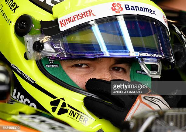 Sahara Force India F1 Team's Mexican driver Sergio Perez sits in his car in the pits during a practice session at Silverstone motor racing circuit in...