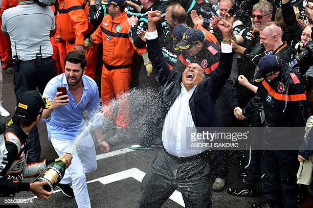 Sahara Force India F1 Team's Mexican driver Sergio Perez sprays champagne as he celebrates in the parc ferme at the Monaco street circuit on May 29...