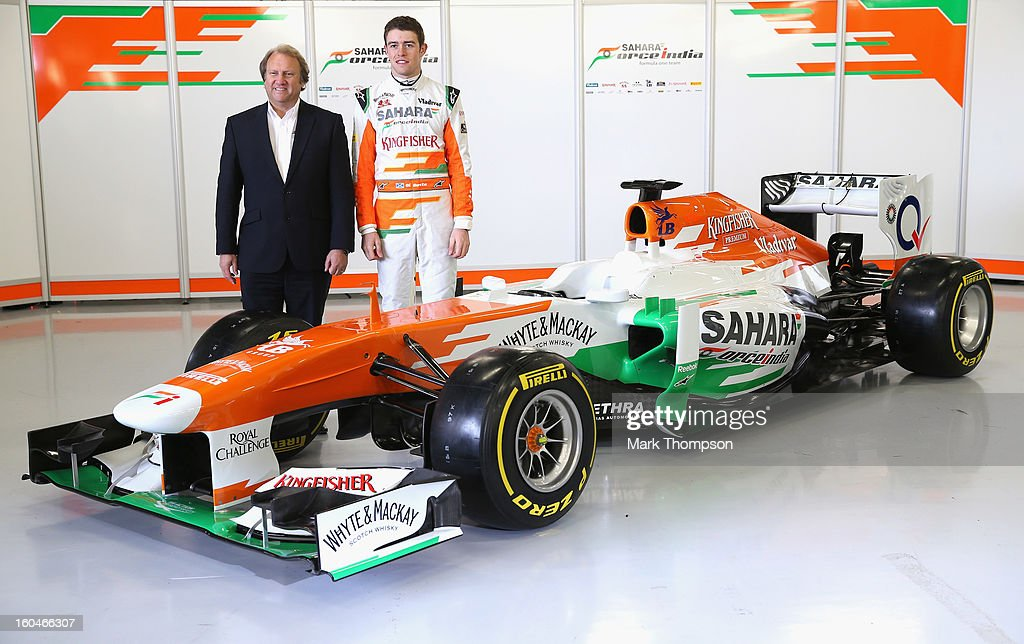 Sahara Force India Formula 1 driver <a gi-track='captionPersonalityLinkClicked' href=/galleries/search?phrase=Paul+Di+Resta&family=editorial&specificpeople=4239339 ng-click='$event.stopPropagation()'>Paul Di Resta</a> of Great Britain and deputy team principal Robert Fearnley with the team's new car for the 2013 Formula 1 season, the VJM06, during the launch at the Silverstone circuit on February 1, 2013 in Northampton, England.