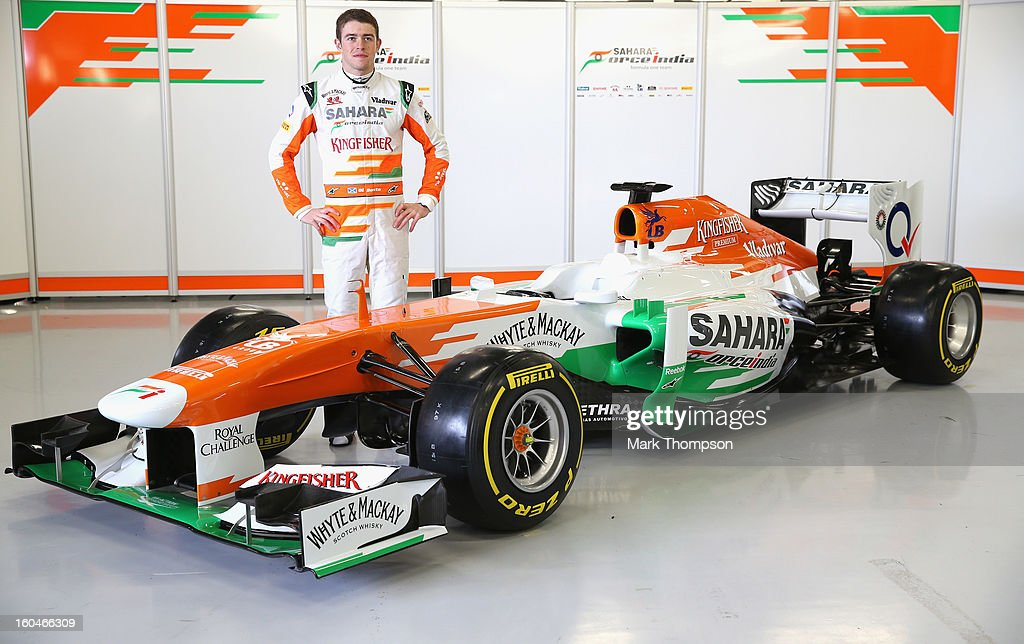 Sahara Force India Formula 1 driver Paul Di Resta of Great Britain with the team's new car for the 2013 Formula 1 season, the VJM06, during the launch at the Silverstone circuit on February 1, 2013 in Northampton, England.