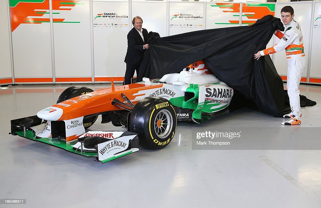 Sahara Force India Formula 1 driver <a gi-track='captionPersonalityLinkClicked' href=/galleries/search?phrase=Paul+Di+Resta&family=editorial&specificpeople=4239339 ng-click='$event.stopPropagation()'>Paul Di Resta</a> of Great Britain and deputy team principal Robert Fearnley unveil the team's new car for the 2013 Formula 1 season, the VJM06, during the launch at the Silverstone circuit on February 1, 2013 in Northampton, England.