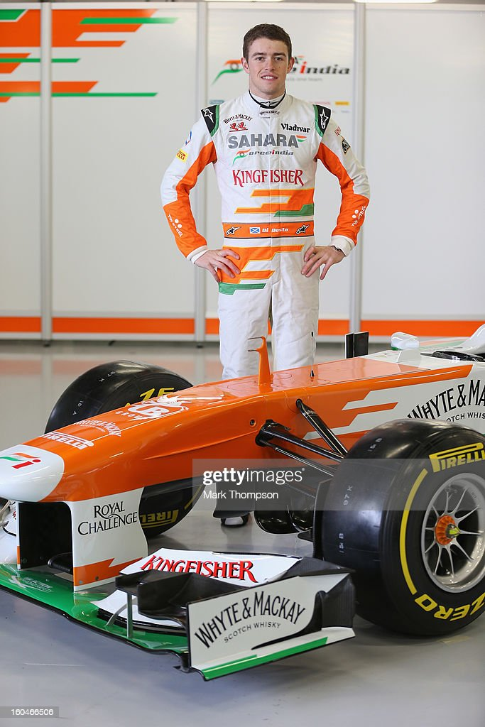 Sahara Force India Formula 1 driver <a gi-track='captionPersonalityLinkClicked' href=/galleries/search?phrase=Paul+Di+Resta&family=editorial&specificpeople=4239339 ng-click='$event.stopPropagation()'>Paul Di Resta</a> of Great Britain with the team's new car for the 2013 Formula 1 season, the VJM06, during the launch at the Silverstone circuit on February 1, 2013 in Northampton, England.