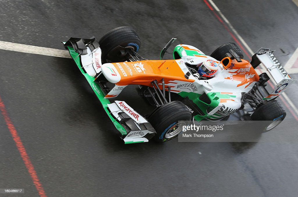 Sahara Force India Formula 1 driver <a gi-track='captionPersonalityLinkClicked' href=/galleries/search?phrase=Paul+Di+Resta&family=editorial&specificpeople=4239339 ng-click='$event.stopPropagation()'>Paul Di Resta</a> of Great Britain drives the team's new car for the 2013 Formula 1 season, the VJM06, during the launch at the Silverstone circuit on February 1, 2013 in Northampton, England.