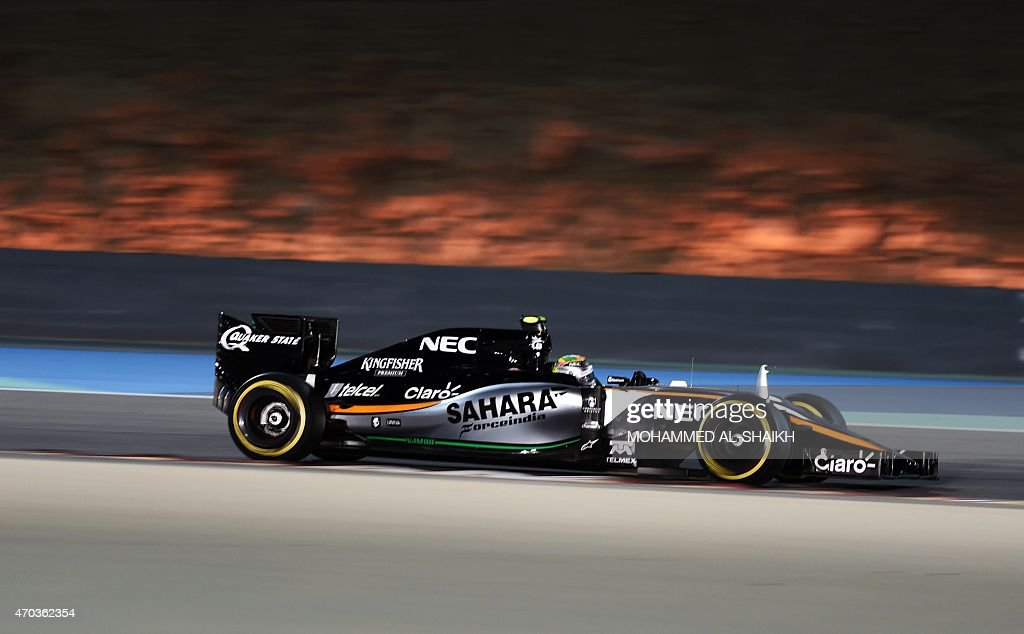 Sahara Force india Mexican driver Sergio Perez drives during the Formula One Bahrain Grand Prix at the Sakhir circuit in the desert south of the Bahraini capital, Manama, on April 19, 2015.