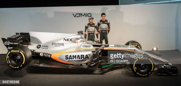 Sahara Force India's Mexican Formula One driver Sergio Perez and French Formula One racing driver Esteban Ocon attend the launch of the Sahara Force...
