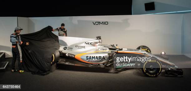 Sahara Force India's Mexican Formula One driver Sergio Perez and French Formula One racing driver Esteban Ocon unveil the Sahara Force India Formula...