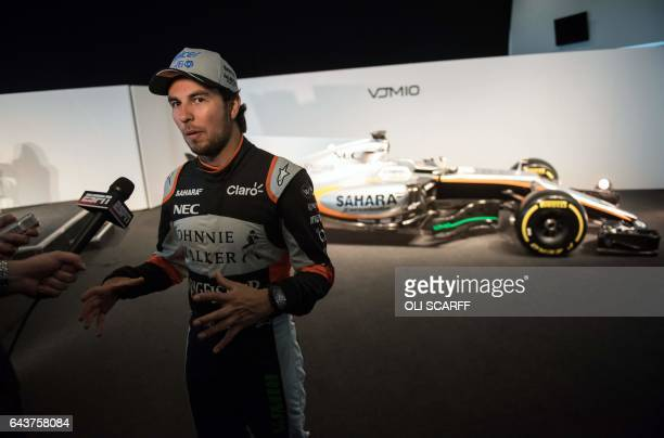Sahara Force India's Mexican Formula One driver Sergio Perez is interviewed at the launch of the Sahara Force India Formula One car for the 2017...