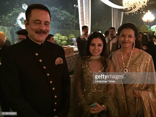 Sahara Group Chief Subrata Roy with his wife Swapna Roy and Cricketer MS Dhoni's wife Sakshi Dhoni during the wedding reception of Indian Cricketer...