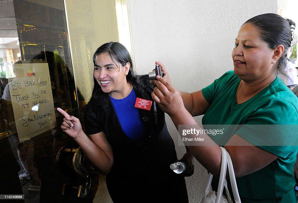 Sahara Hotel & Casino food server Barbara Nunez (L) and Margharita Pinon, a hostess at the Sahara for 23 years, take photos of a note posted on the front door of the resort by SBE Entertainment Group CEO Sam Nazarian after the property closed on May 16, 2011 in Las Vegas, Nevada. The Sahara's current owner SBE Entertainment Group closed the 1,720-room resort, which first opened in 1952, and plans to redevelop the site in the future.