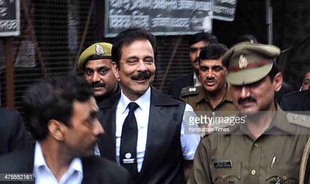 Sahara India chief Subrata Roy is escorted by the police officials after he surrendered to appear before the chief judicial magistrate on February 28...