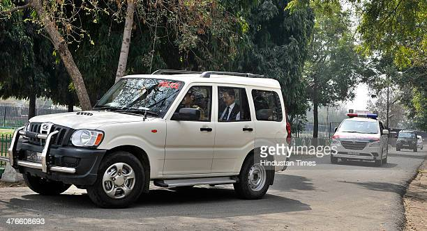 Sahara India Chief Subrata Roy leaves the guest house in Kalandi Kunj in police car to appear before Supreme Court on March 4 2014 in New Delhi India...