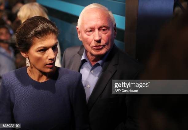 Sahra Wagenknecht top candidate of the Left party and her husband Oskar Lafontaine arrive for an election party night on September 24 2017 in Berlin...