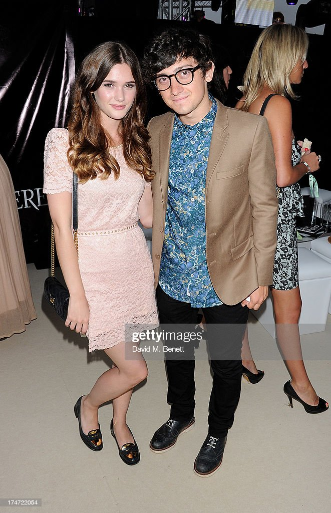 Sai Bennett (L) and Craig Roberts attend the Boujis tent at the Audi International Polo day at Guards Polo Club on July 28, 2013 in Egham, England.