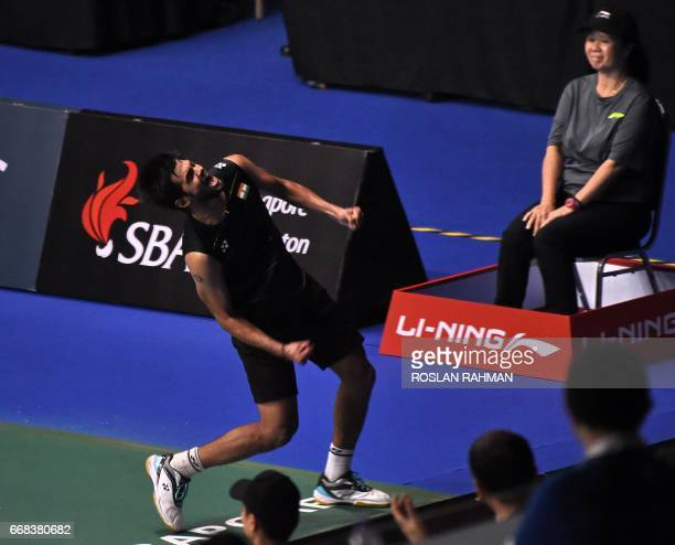Sai Praneeth of India celebrates after his victory over Tanongsak Saengsomboonsuk of Thailand in their men's singles quarterfinal match at the...