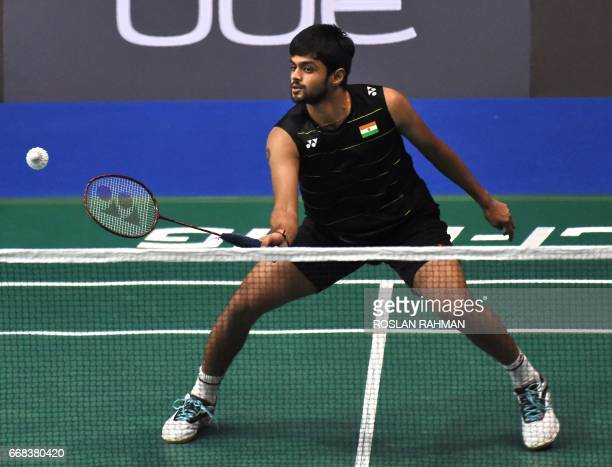 Sai Praneeth of India hits a return against Tanongsak Saengsomboonsuk of Thailand during their men's singles quarterfinal match at the Singapore Open...