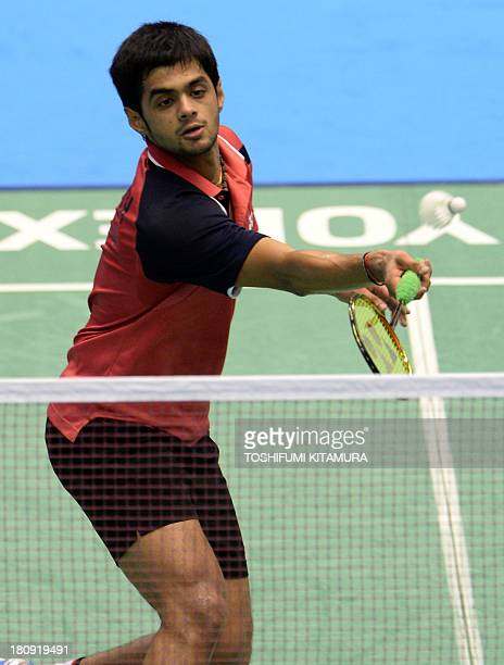 B Sai Praneeth of India hits a return during his first round match against eighthseeded Hu Yun of Hong Kong at the Japan Open 2013 badminton...