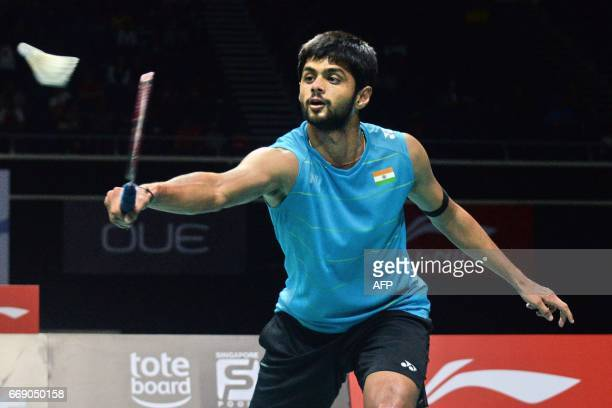 Sai Praneeth of India plays a shot against compatriot Srikanth Kidambi during the men's single finals of the Singapore Open badminton tournament in...
