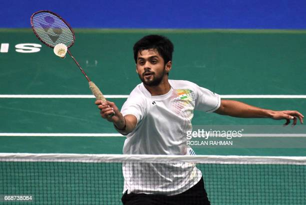 Sai Praneeth of India plays a shot against South Korea's Lee Dong Keun in their men's singles semifinal of the Singapore Open badminton tournament in...
