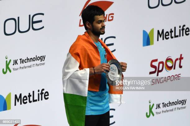 Sai Praneeth of India poses after beating compatriot Srikanth Kidambi to win the men's singles finals of the Singapore Open badminton tournament in...