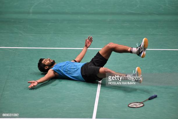 Sai Praneeth of India reacts after beating compatriot Srikanth Kidambi to win the men's single finals of the Singapore Open badminton tournament in...
