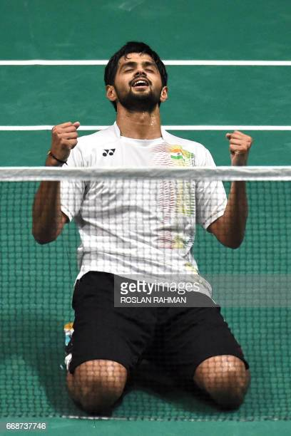 Sai Praneeth of India reacts after defeating South Korea's Lee Dong Keun in their men's singles semifinal of the Singapore Open badminton tournament...