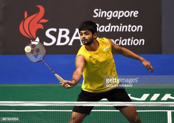 Sai Praneeth of India returns a shot against Qiao Bin of China during the men's singles round two qualifying at the Singapore Open badminton...