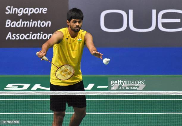 Sai Praneeth of India serves against Qiao Bin of China during the men's singles round two qualifying at the Singapore Open badminton tournament in...