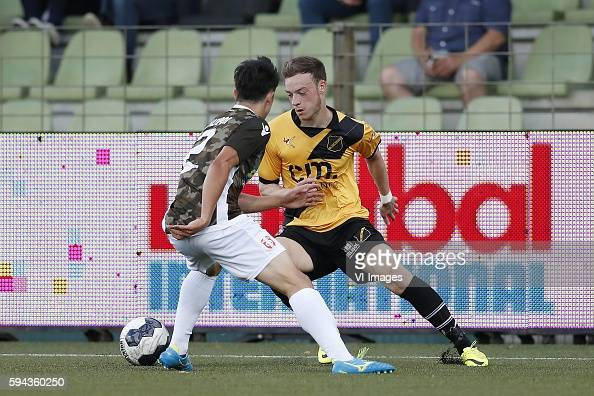 http://media.gettyimages.com/photos/sai-van-wermeskerken-of-fc-dordrecht-brandon-barker-of-nac-breda-the-picture-id594360250?s=594x594