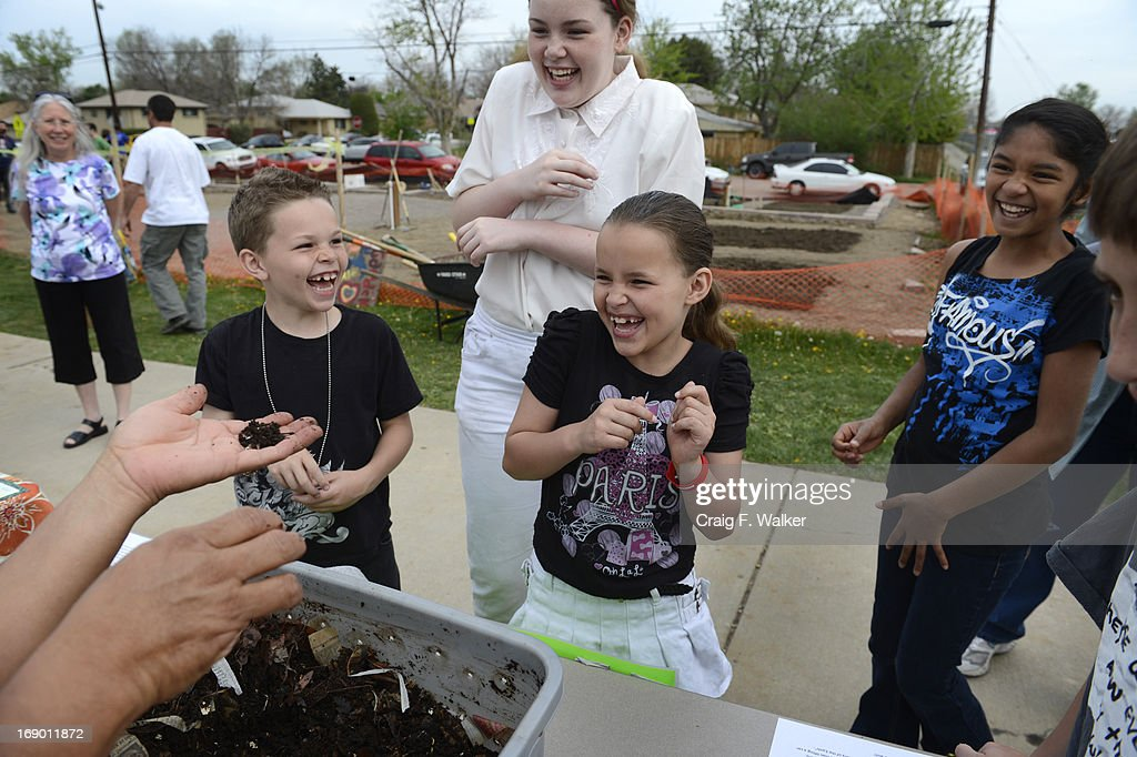 Saiah Brydon, 8, and his sisters, Sierra, 12, and Serenity, 8, react while learning about compost during the North Middle School Garden Festival in Aurora, CO May 18, 2013. The youths had just been informed that the worm castings they were smelling is also called 'worm poop.' The celebration marked the opening of the first school-based community garden in Aurora Public Schools. The project, funded by The Piton Foundation, was made possible through a partnership of Aurora Public Schools, Denver Urban Gardens (DUG), and Anschutz Medical Campus Department of Family Medicine and BRANCH, a multi-disciplinary student organization from the medical campus. A second garden is scheduled to open later this year at Hinkley High School.