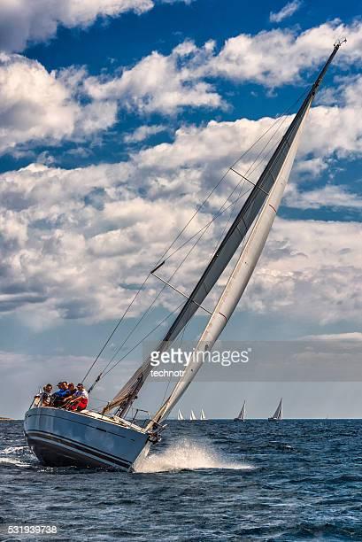Saiboat racing at regatta, front view