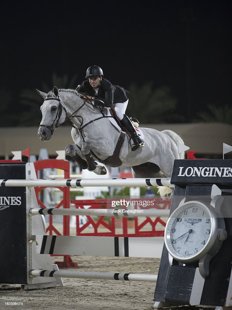 Said Abdel Kader of Egypt clears a hurdle on Der Senaat 111 during the President of the UAE Showjumping Cup - Furusyiah Nations Cup Series presented by Longines on February 21, 2013 in Al Ain, United Arab Emirates.