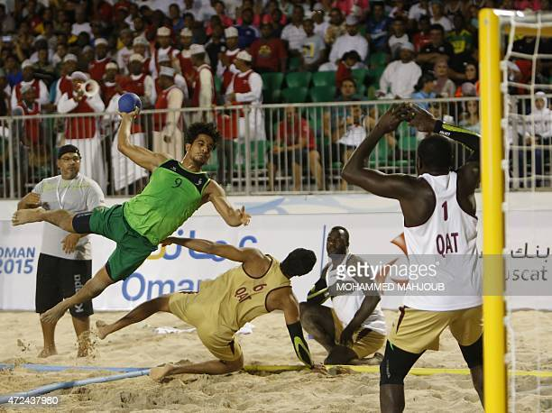 Said alHabsi of Oman attempts a shot on goal during the Asian Beach Handball Championship final match between Oman and Qatar in Muscat on May 7 2015...