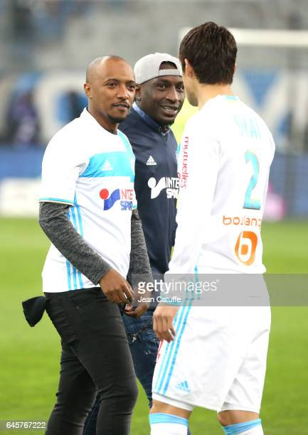 Said M'Roumbaba aka Soprano and Mamadou Niang kick off the French Ligue 1 match between Olympique de Marseille and Paris Saint Germain at Stade...