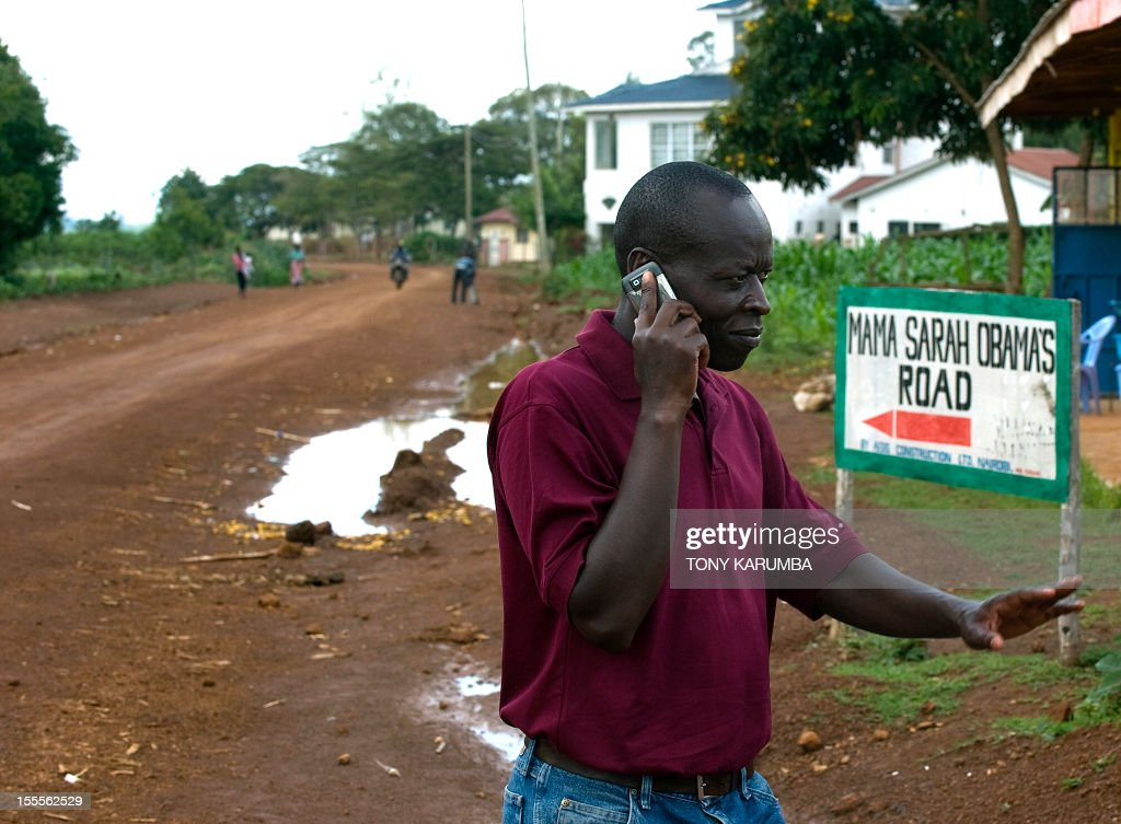 Said Obama walks along Mama Sarah Obama road, named after US President Barack Obama's step-grandmother Sarah, on November 5, 2012 in the western Kenyan hamlet of Kogelo a day before US elections. Obama's father was born in Kogelo. AFP PHOTO/Tony KARUMBA