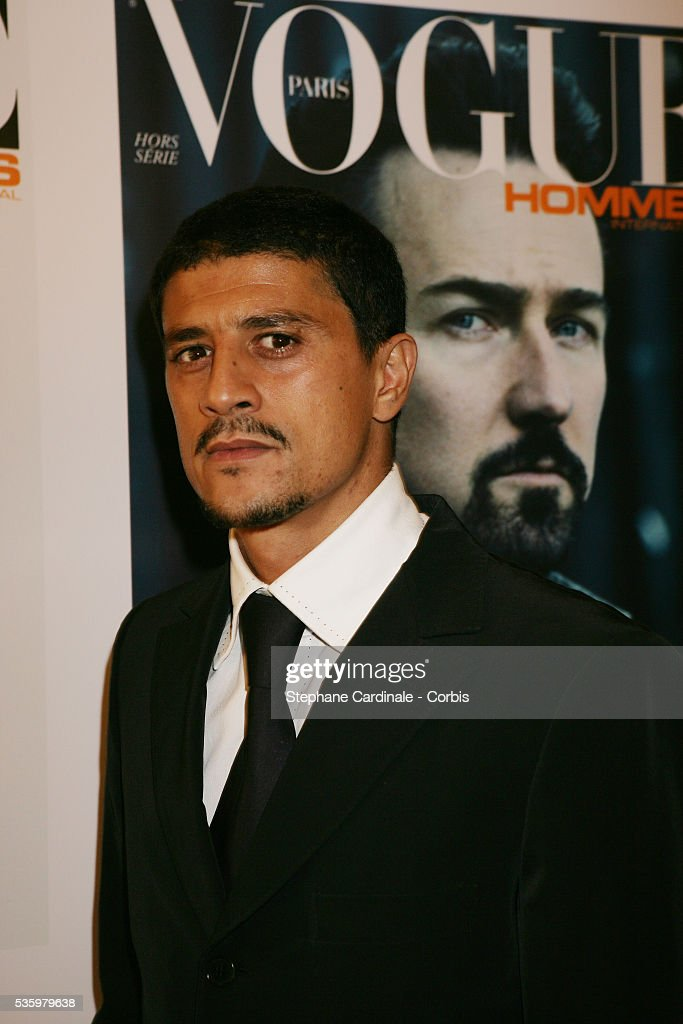 Said Tagmaoui arrives at the 'Vogue Party' held at the VIP Room in Paris.